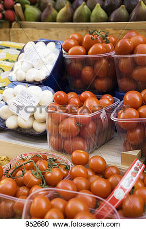 Stock Photography of Tomatoes and mushrooms in plastic punnets at.