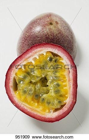 Stock Photograph of Purple granadilla (passion fruit), halved.