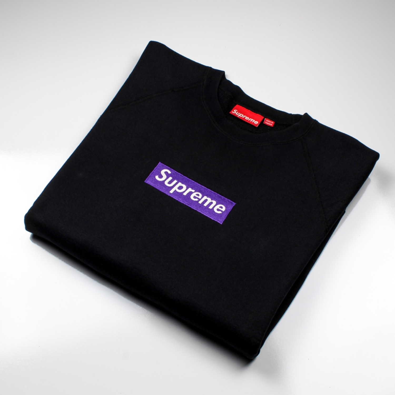Purple On Black Supreme Box Logo Crewneck.