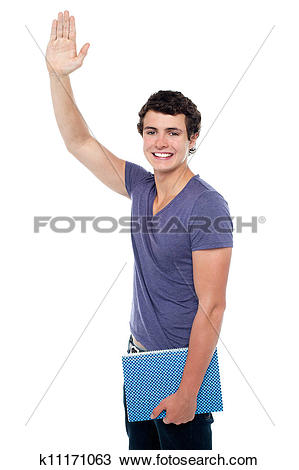 Stock Photo of Handsome young guy putting his right hand up.