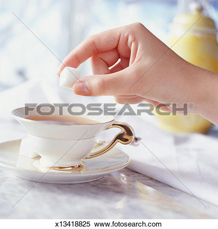 Stock Image of Woman putting sugar cube in tea cup, Close.