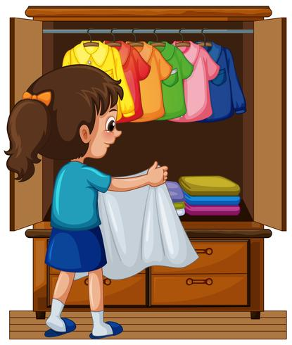 Girl putting away clothes in closet.