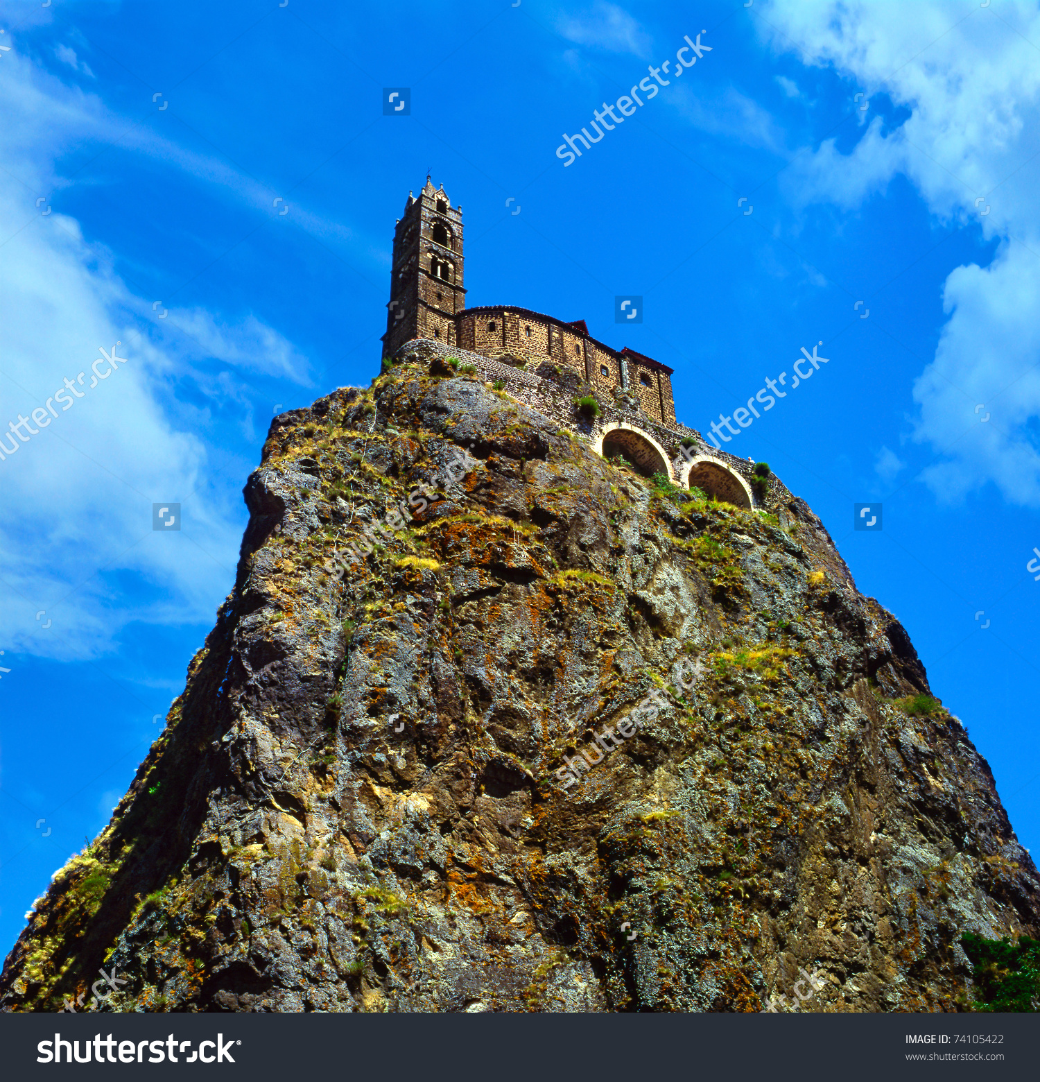 Ancient Church Standing At A Very Steep Volcanic Needle (Le Puy.
