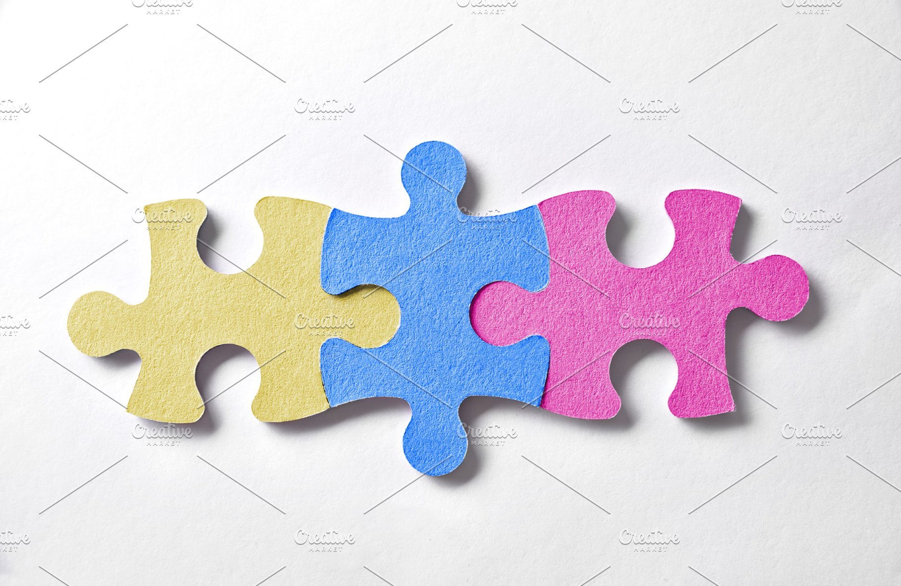 Three colorful puzzle pieces logo.