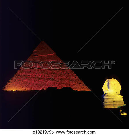 Stock Image of Great Pyramid of Giza and The Sphinx at night.