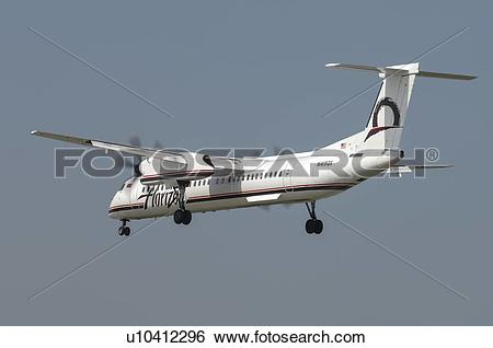 Stock Images of Bombardier Q400 of Horizon Airline landing at Los.