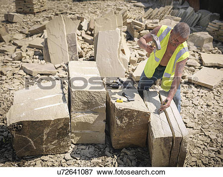 Picture of Quarry worker splitting sandstone in Yorkshire stone.