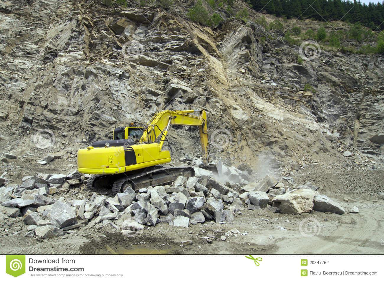 Excavator In Stone Quarry Stock Photography.