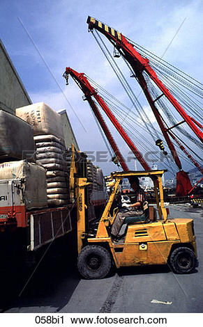 Stock Photography of Fork Lift Truck loading at Quayside Korea.