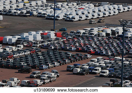 Stock Photograph of Cars and vans awaiting shipment on quayside.
