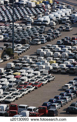 Stock Photo of Cars and vans awaiting shipment on quayside.