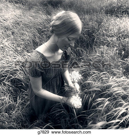Stock Photograph of 1970S Woman In Field Of Waist.