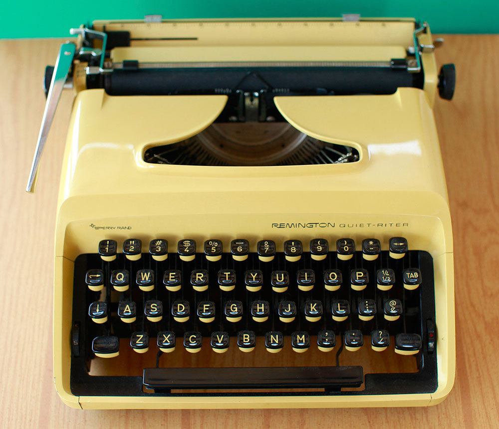 Vintage Yellow Remington Quiet Riter Manual Typewriter by FreshPie.
