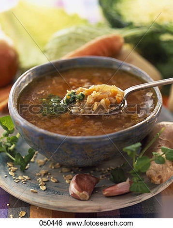 Stock Images of Oat and quinoa soup with vegetables and watercress.