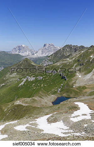 Stock Photo of Switzerland, Grisons, Ratikon, Lake Grfiersee with.