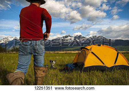 Stock Photography of Man walks to his campsite in the Palmer.