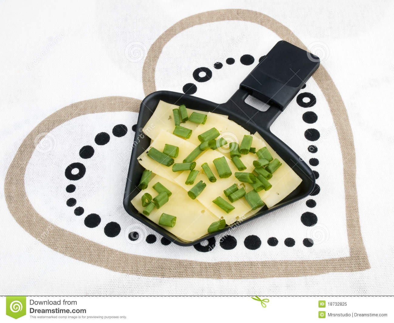 Raclette Pan With Cheese And Spring Onion Royalty Free Stock Photo.