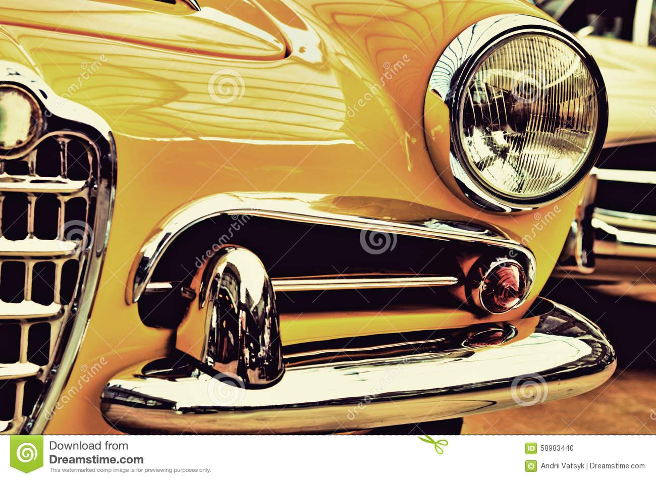 The Hood, Bumper, Headlight And Radiator Of Stylish Yellow Vinta.