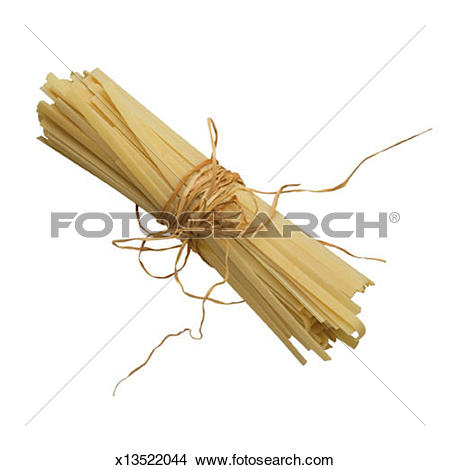 Stock Photo of Dried Pasta Wrapped in Raffia x13522044.