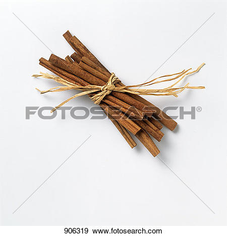 Stock Photograph of Cinnamon Sticks Tied with Raffia 906319.