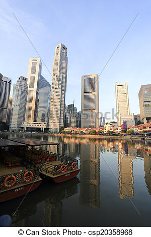 Stock Image of Singapore River with the skyline of Raffles Place.