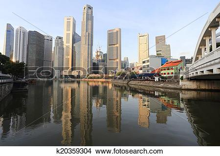 Stock Photo of Singapore River with the skyline of Raffles Place.
