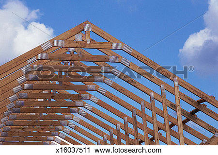 Stock Photography of Rafters and roof trussing of building under.