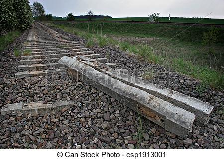 Stock Photography of demolished rail bed and rail tracks.