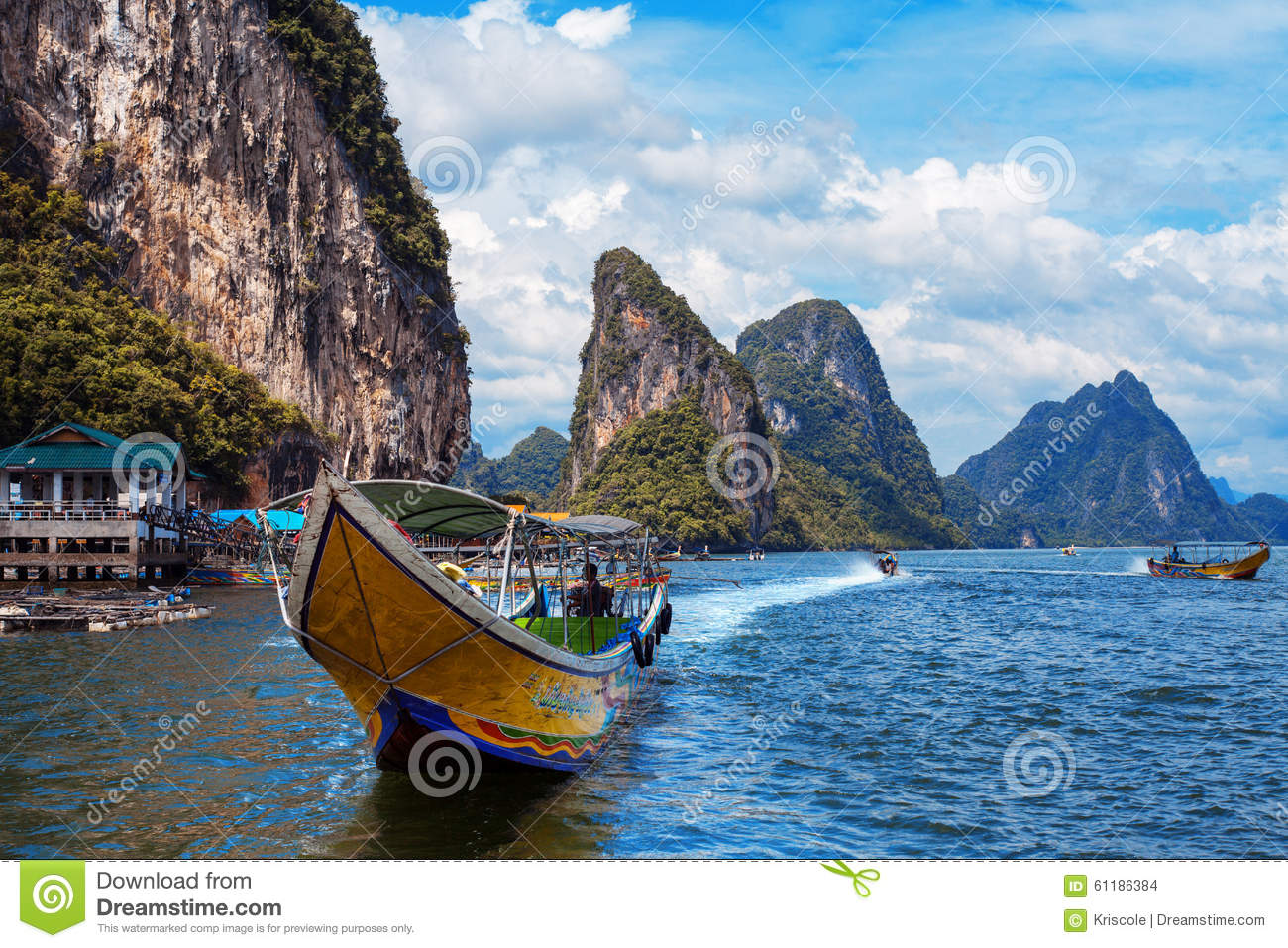 Long Boat And Rocks On Railay Beach In Thailand Stock Photo.