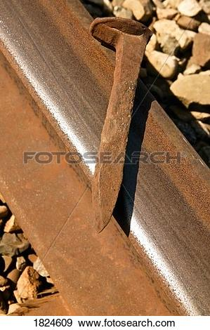 Stock Photograph of Rusty nail on a railroad tie 1824609.