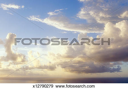 Stock Photograph of Cumulus clouds and rain shower over sea, full.