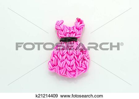 Stock Photograph of Pink elastic rainbow loom bands dress shaped.
