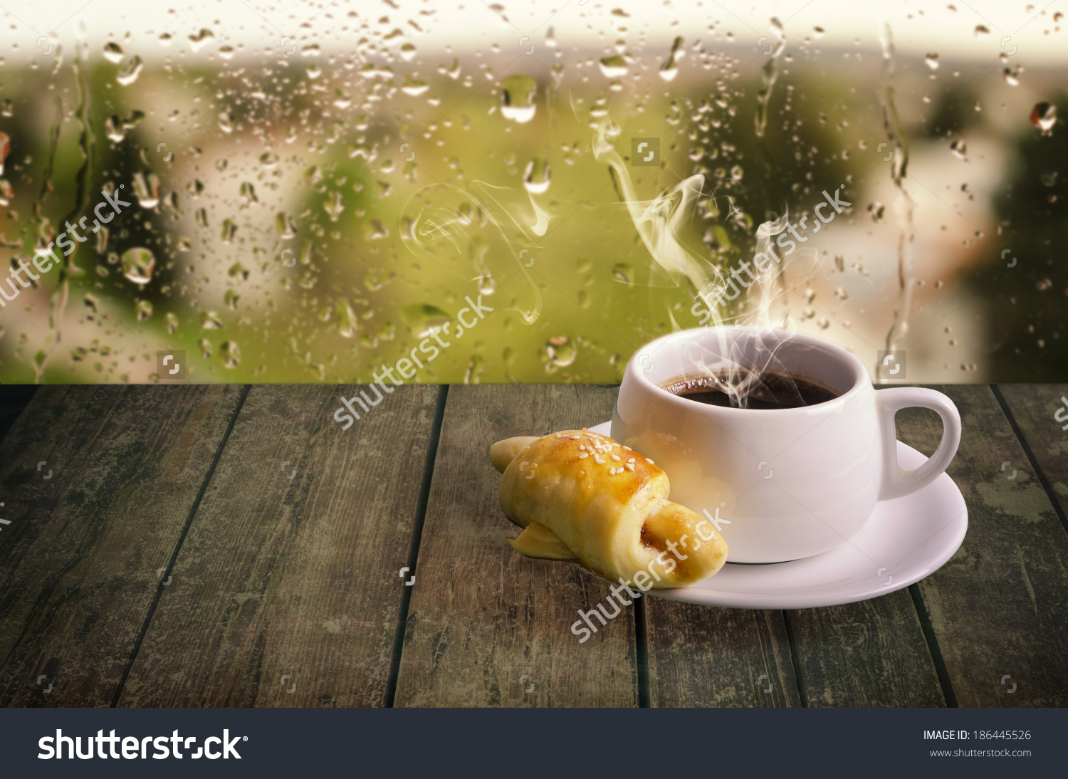 Steaming Coffee Cup On Rainy Day Stock Photo 186445526.
