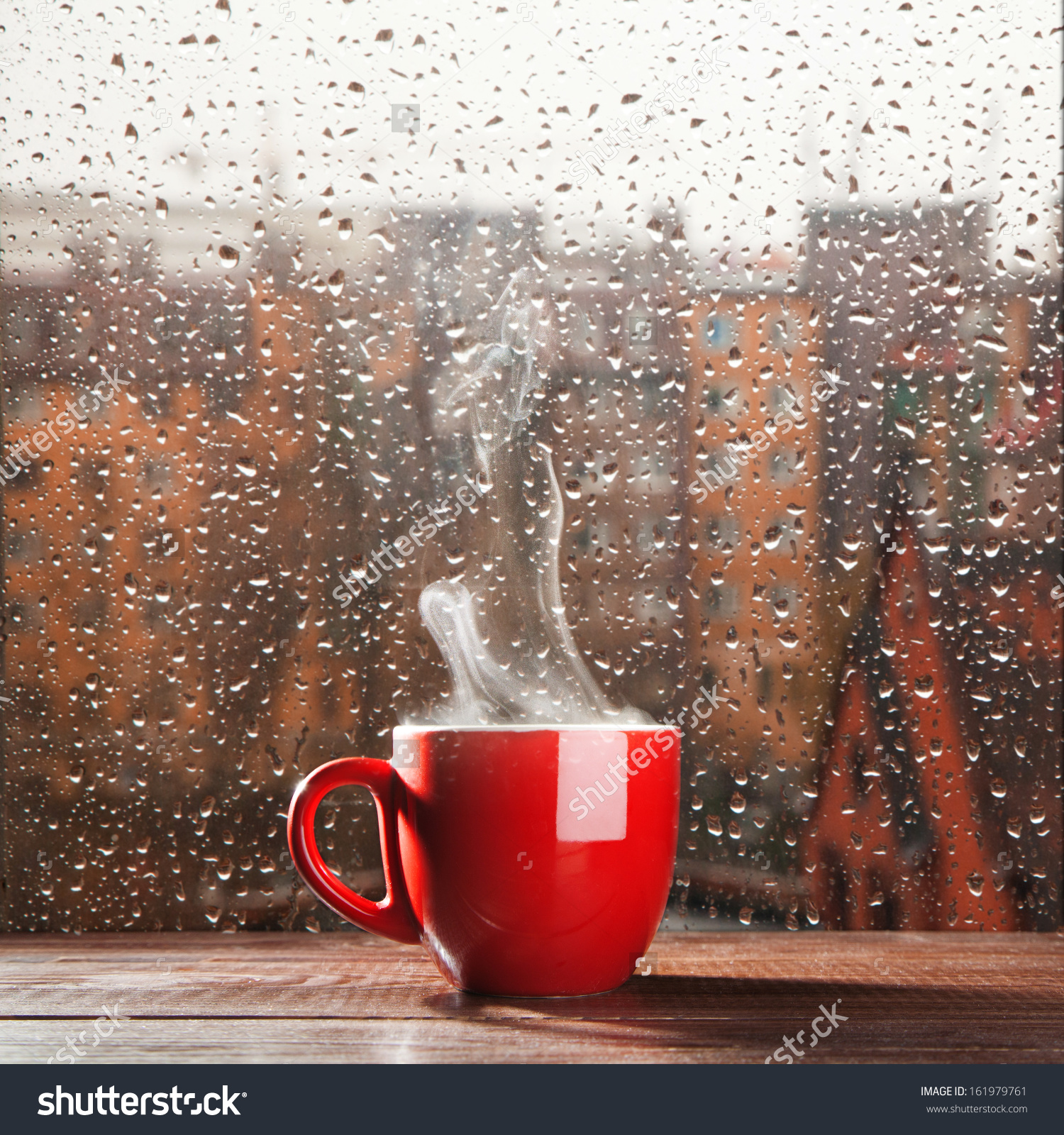 Steaming Coffee Cup On Rainy Day Stock Photo 161979761.