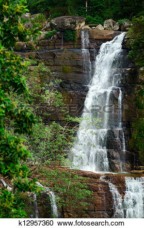 Stock Photography of Large waterfalls in green tropical forest at.