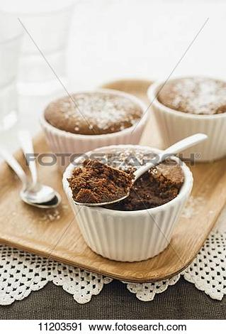 Stock Photography of Mocha and caramel pudding in ramekins.