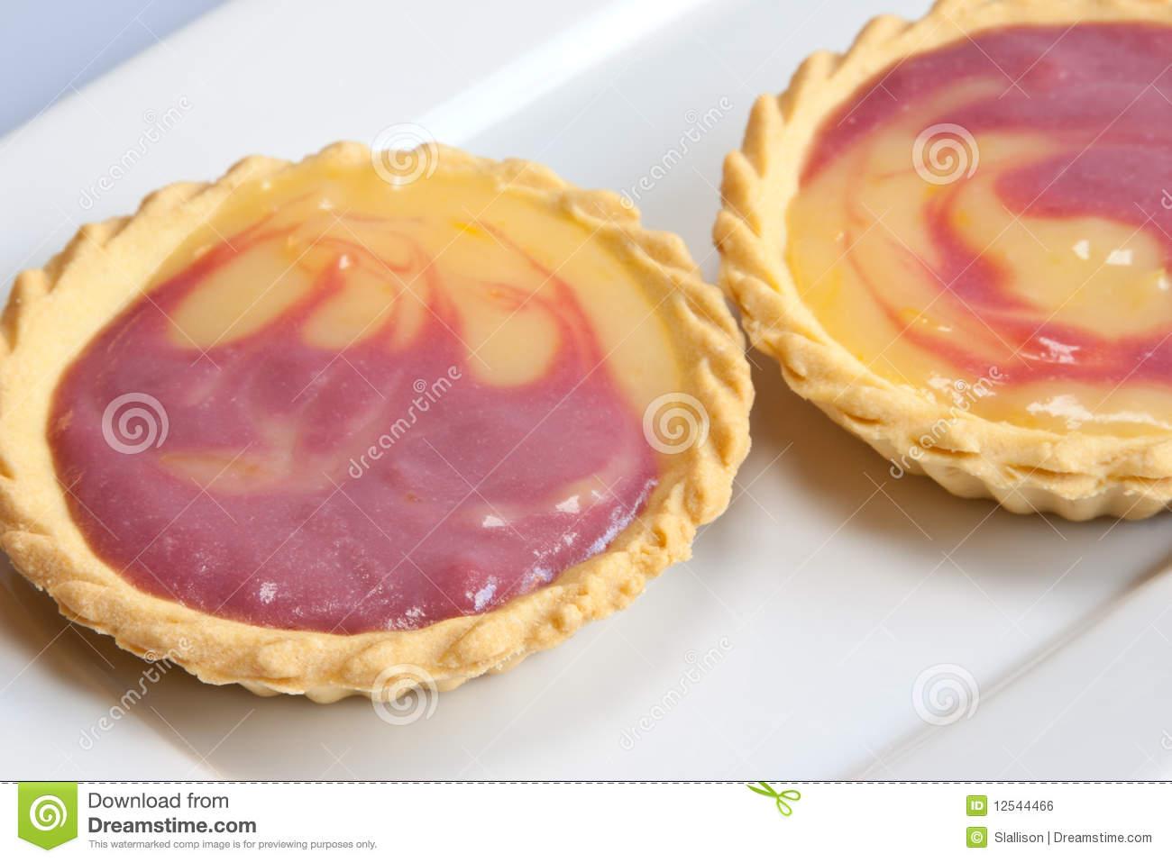 Raspberry & Lemon Curd Tarts Royalty Free Stock Image.