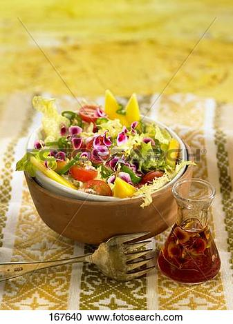 Stock Photography of Mallow,lettuce,cherry tomato and mango salad.
