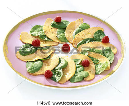 Stock Images of Foie gras carpaccio with spinach and raspberry.