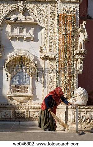 Stock Photo of Woman dusting outside the Karni Mata Rat Temple.