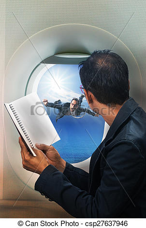 Stock Photo of business man reading book in passenger plane seat.