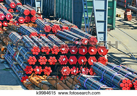 Stock Image of Stacked PVC and steel pipe ready for shipment.