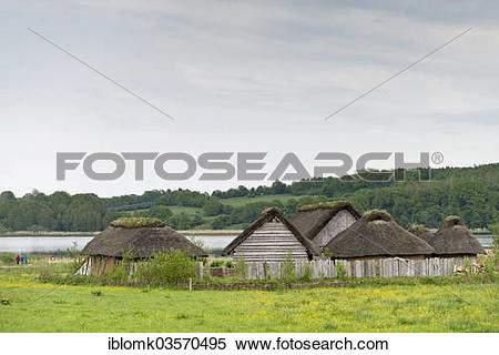 """Stock Image of """"Reconstructed Viking houses with thatched roofs."""