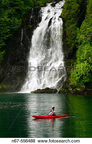Pictures of Man sea kayaking in front of Red Bluff Bay Falls, Red.