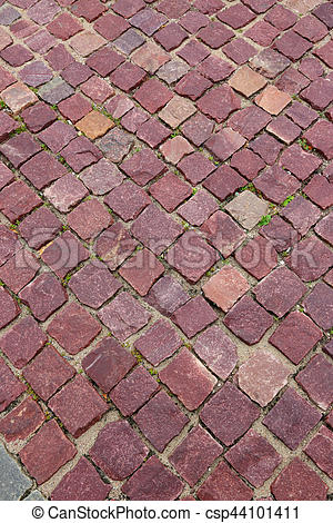Stock Photography of red granite pavers on the sidewalk.
