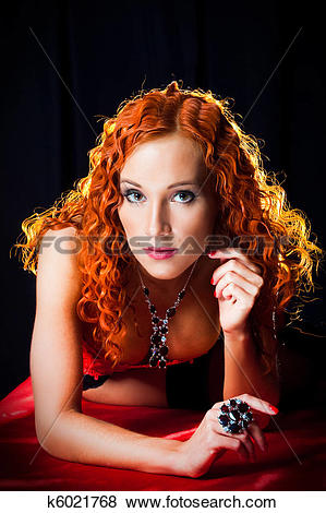 Pictures of Sexy girl with red hair wearing amber ring and.