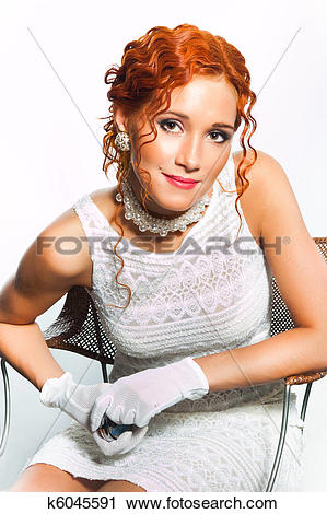 Stock Photography of girl with red curly hair wearing white dress.