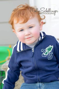 Cute little boy with his curly red hair.