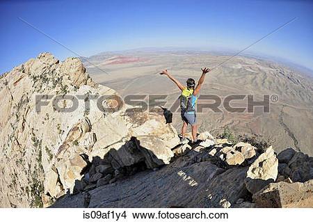 Stock Photo of Female hiker celebrating on ridge, Mount Wilson.