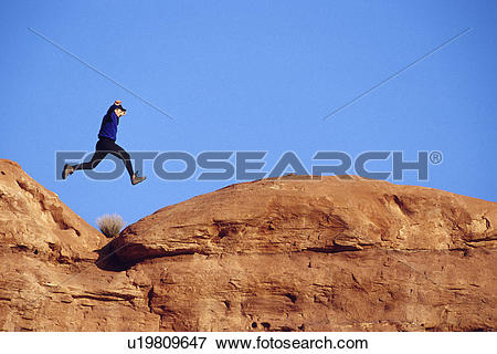 Picture of Man Leaping Over Red Rocks u19809647.